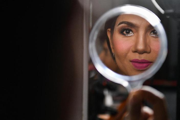 Transgender people are often passed over for jobs as teachers and civil servants and confined to entertainment gigs and sex work (AFP Photo/Chalinee Thirasupa)