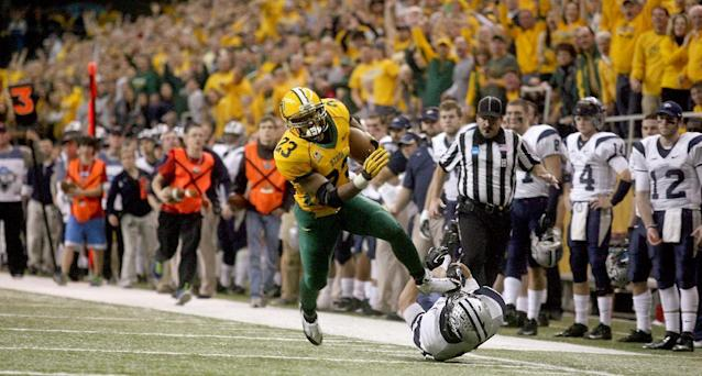 North Dakota State running back John Crockett (23) eludes New Hampshire defender Hayden Knudson (46) during the first half of an NCAA Football Championship Subdivision semifinal game on Friday, Dec. 20, 2013, at the Fargodome in Fargo, N.D. (AP Photo/Bruce Crummy)