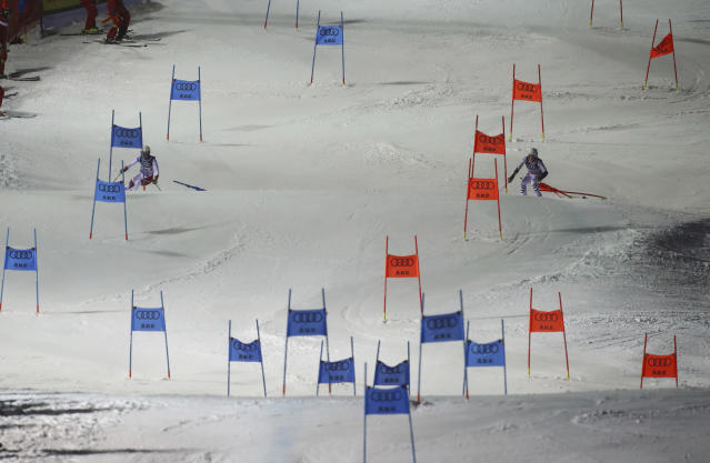 A moment of the race between Switzerland and Germany during the team event, at the alpine ski World Championships in Are, Sweden, Tuesday, Feb. 12, 2019. (AP Photo/Alessandro Trovati)
