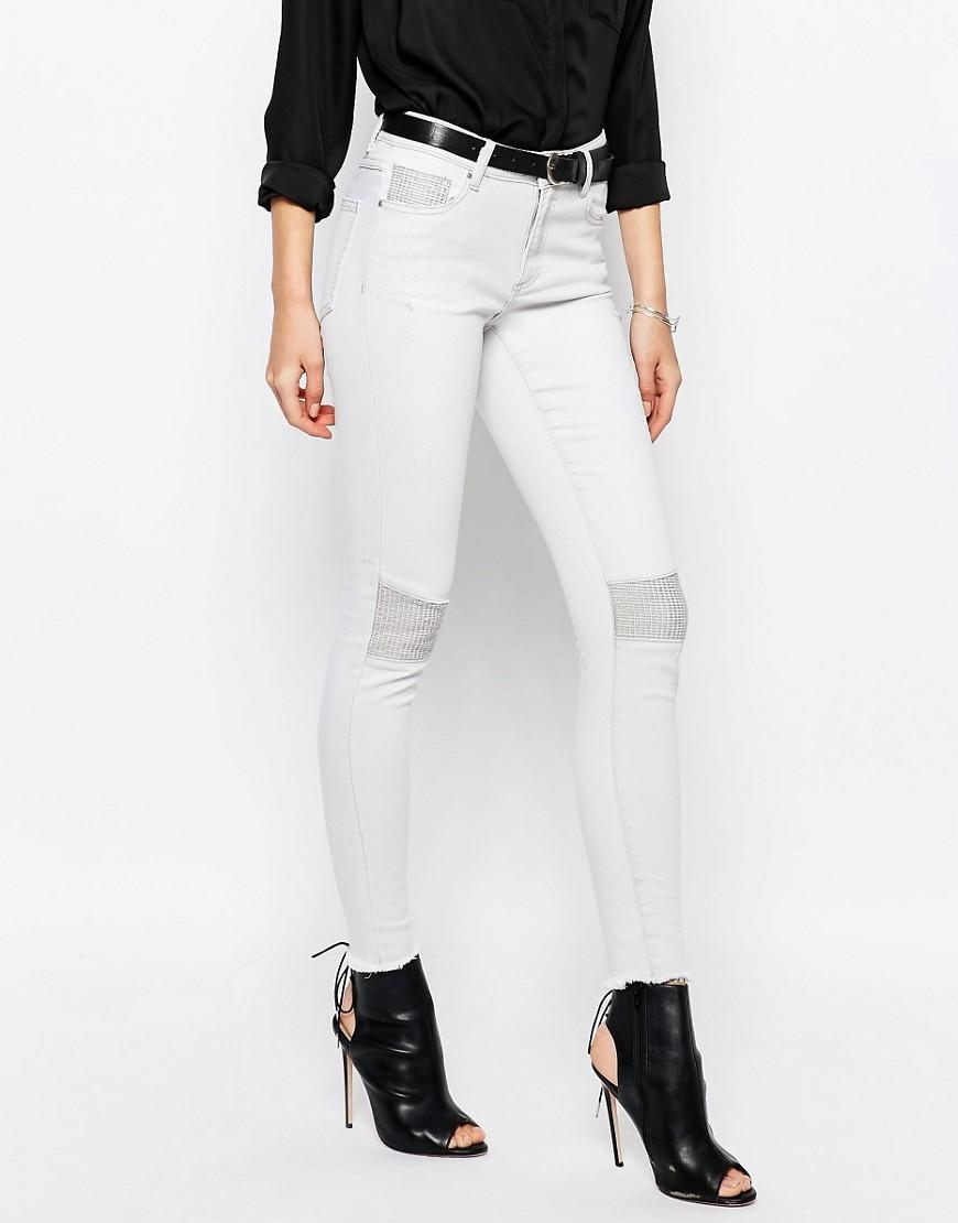 "<p>These pants add instant badass and usually come in a stretchy, super comfortable fabric that perfectly hugs your body. While black is the go-to colour for biker pants, this white pair makes an unexpected statement.</p><p><i>Vila Skinny Biker Jeans, $28, <a href=""http://www.asos.com/vila/vila-skinny-biker-jeans/prod/pgeproduct.aspx?iid=6552013&clr=Lightgreydenim&SearchQuery=biker+jeans&pgesize=13&pge=0&totalstyles=13&gridsize=3&gridrow=3&gridcolumn=1"" rel=""nofollow noopener"" target=""_blank"" data-ylk=""slk:asos.com"" class=""link rapid-noclick-resp"">asos.com</a></i></p>"