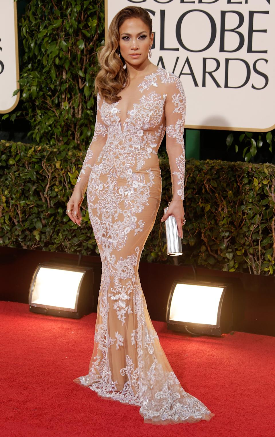 <p>It's virtually impossible for Jennifer Lopez not to be one of the best dressed people in any room. However this nude and white lace Zuhair Murad in 2013 dress proves that Lopez is and will always be a red carpet stand-out.<em> (Image via Getty Images)</em></p>