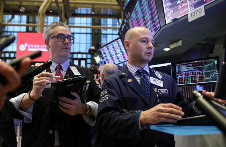 FILE PHOTO: Traders work on the floor of the New York Stock Exchange (NYSE) in New York, U.S., November 8, 2018. REUTERS/Brendan McDermid