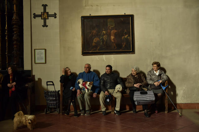 <p>People wait with their pets inside Saint Pablo church to receive blessings during the feast of St. Anthony, Spain's patron saint of animals, in Zaragoza, northern Spain, Wednesday, Jan.17, 2018. (Photo: Alvaro Barrientos/AP) </p>