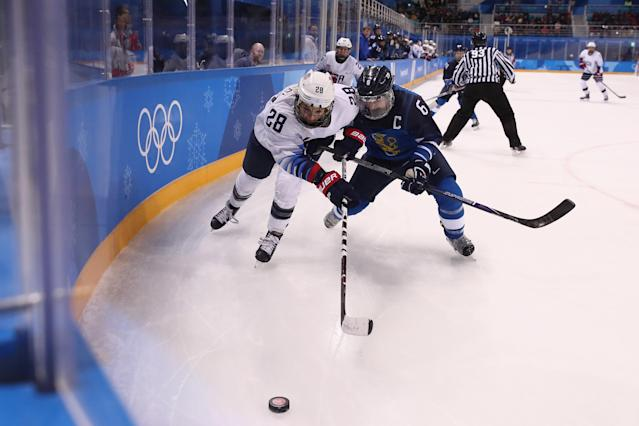 Amanda Kessel of the United States and Jenni Hiirikoski #6 of Finland battle for the puck in the first period during the Women's Ice Hockey Preliminary Round. (Getty)