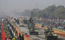Battle tanks move through the ceremonial Rajpath boulevard during India's Republic Day celebrations in New Delhi, India, Tuesday, Jan. 26, 2021. Republic Day marks the anniversary of the adoption of the country's constitution on Jan. 26, 1950. (AP Photo/Manish Swarup)
