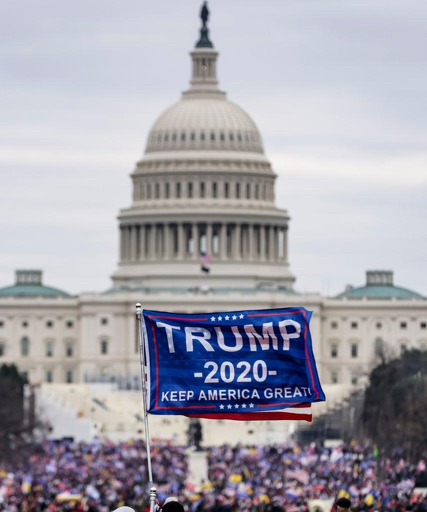 WASHINGTON, DC – JANUARY 06: Pro-Trump supporters storm the U.S. Capitol following a rally with President Donald Trump on January 6, 2021 in Washington, DC. Trump supporters gathered in the nation's capital today to protest the ratification of President-elect Joe Biden's Electoral College victory over President Trump in the 2020 election. (Photo by Samuel Corum/Getty Images)