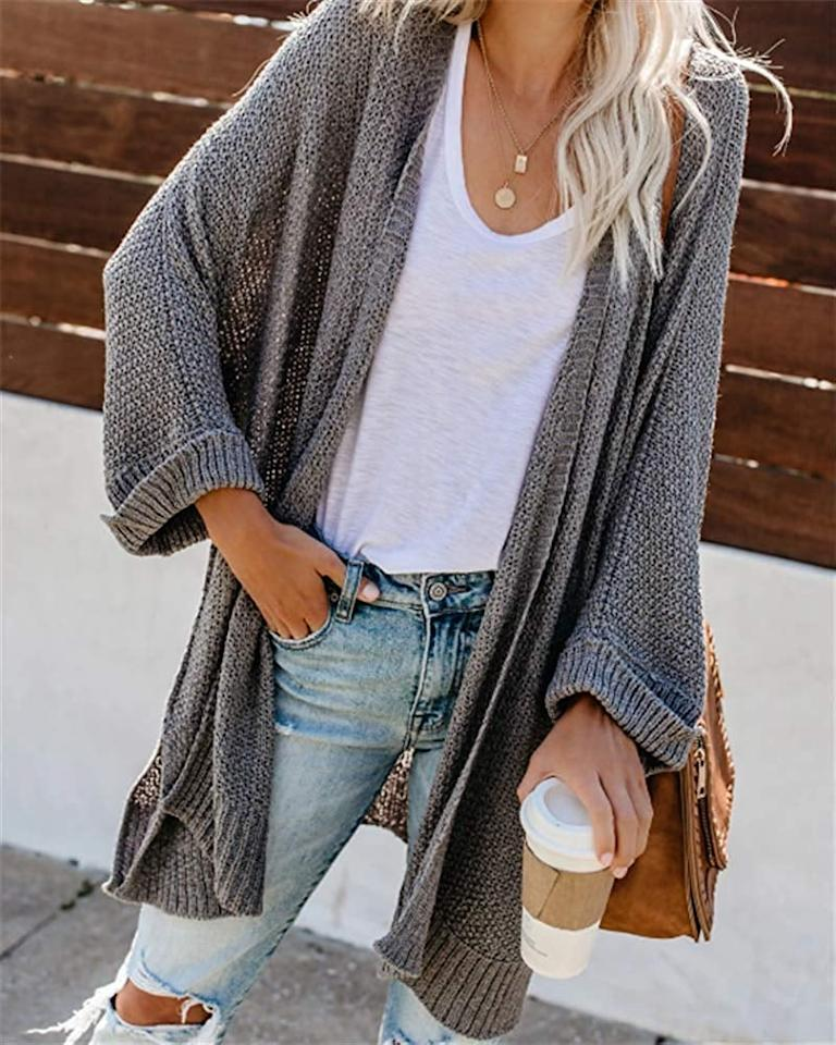 "<p>We love the comfy cut of this <a href=""https://www.popsugar.com/buy/Cordat-Casual-Loose-Cardigan-508159?p_name=Cordat%20Casual%20Loose%20Cardigan&retailer=amazon.com&pid=508159&price=27&evar1=fab%3Aus&evar9=46822302&evar98=https%3A%2F%2Fwww.popsugar.com%2Fphoto-gallery%2F46822302%2Fimage%2F46822437%2FCordat-Casual-Loose-Cardigan&list1=shopping%2Cfall%20fashion%2Camazon%2Csweaters%2Ccardigans%2Cwinter%20fashion&prop13=api&pdata=1"" rel=""nofollow"" data-shoppable-link=""1"" target=""_blank"" class=""ga-track"" data-ga-category=""Related"" data-ga-label=""https://www.amazon.com/cordat-Womens-Sweater-Knitted-Cardigan/dp/B07YBXRP5L/ref=sr_1_1_sspa?crid=8FVWJYQFW6WV&amp;keywords=cardigans%2Bfor%2Bwomen&amp;qid=1572367685&amp;sprefix=cardigans%2Caps%2C217&amp;sr=8-1-spons&amp;spLa=ZW5jcnlwdGVkUXVhbGlmaWVyPUE1SVgwSkJMUlFJUU0mZW5jcnlwdGVkSWQ9QTA0NTAyMzZVRkMzU0o2QzNDVDcmZW5jcnlwdGVkQWRJZD1BMDAyMDY2MTJZNko1TzdBTlU3WjAmd2lkZ2V0TmFtZT1zcF9hdGYmYWN0aW9uPWNsaWNrUmVkaXJlY3QmZG9Ob3RMb2dDbGljaz10cnVl&amp;th=1&amp;psc=1"" data-ga-action=""In-Line Links"">Cordat Casual Loose Cardigan </a> ($27).</p>"