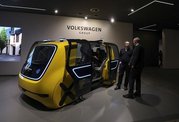 Attendees look at a Volkswagen AG (VW) Sedric concept electric autonomous robo-taxi ahead of the 88th Geneva International Motor Show in Geneva, Switzerland, on March 5, 2018. The show opens to the public on March 8. Photographer: Chris Ratcliffe/Bloomberg