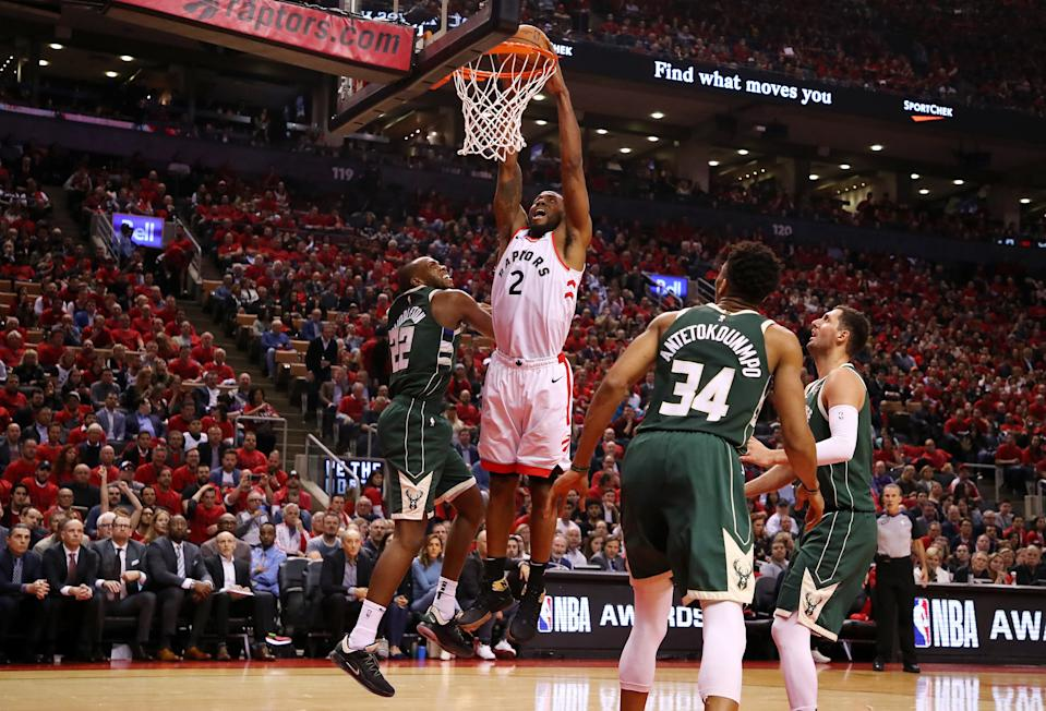 TORONTO, ONTARIO - MAY 21: Kawhi Leonard #2 of the Toronto Raptors dunks the ball during the second half against the Milwaukee Bucks in game four of the NBA Eastern Conference Finals at Scotiabank Arena on May 21, 2019 in Toronto, Canada. NOTE TO USER: User expressly acknowledges and agrees that, by downloading and or using this photograph, User is consenting to the terms and conditions of the Getty Images License Agreement. (Photo by Gregory Shamus/Getty Images)