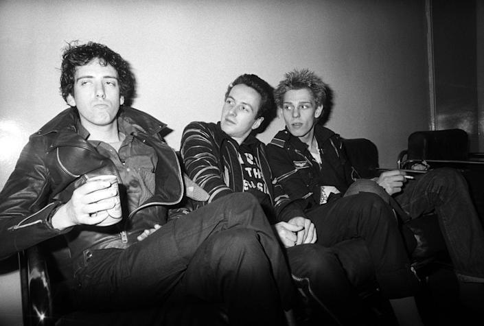 <p>Joe Strummer, Paul Simonon, and Mick Jones of the Clash backstage at the Rainbow Theatre on the White Riot tour on June 9, 1977.</p>