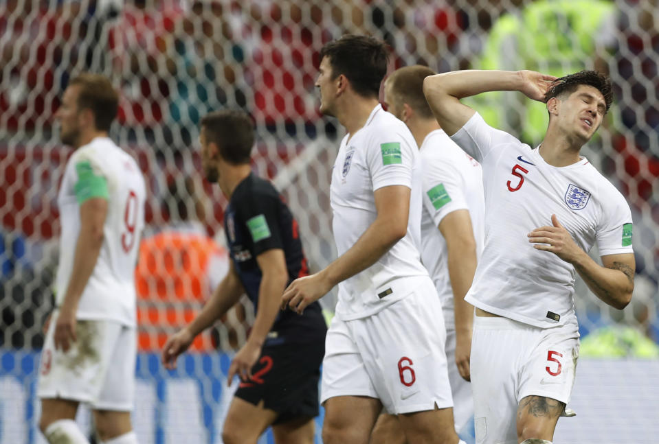 <p>John Stones (no.5) is frustrated after his header was cleared off the line </p>