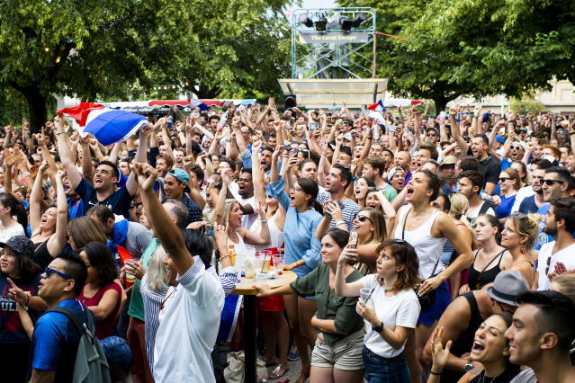 """PHU30851 PUVI. (Switzerland Schweiz Suisse), 15/07/2018.- French supporters celebrate the victory during the public viewing of the FIFA 2018 World Cup final soccer match between France and Croatia, in a fan zone at """"The Great Escape"""", in Lausanne, Switzerland, 15 July 2018. (Croacia, Mundial de Fútbol, Suiza, Francia, Estados Unidos) EFE/EPA/JEAN-CHRISTOPHE BOTT"""