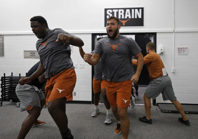 Texas Longhorns' Christian Jones (left), Samuel Cosmi, and others run into their morning workout Wednesday Sept. 4, 2019 in Austin, Tx. ( Photo by Edward A. Ornelas )