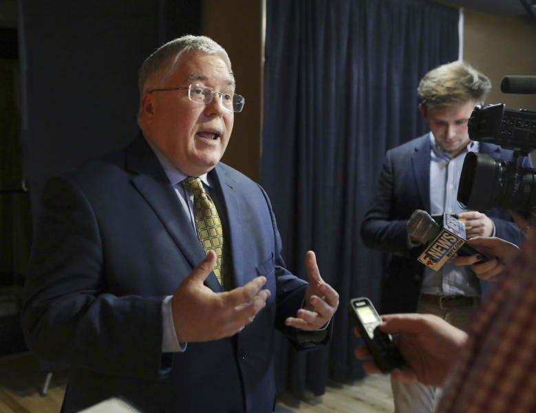 FILE - In this Nov. 1, 2018, file photo, Patrick Morrisey speaks to reporters after a debate in Morgantown, W.Va. West Virginia's Roman Catholic diocese has released the names of nine more priests who it said have been credibly accused of child sexual abuse. West Virginia Attorney General Patrick Morrisey in March 2019 filed a lawsuit accusing the diocese and former Bishop Michael Bransfield of knowingly employing pedophiles and failing to conduct adequate background checks on camp and school workers. (AP Photo/Raymond Thompson, File)