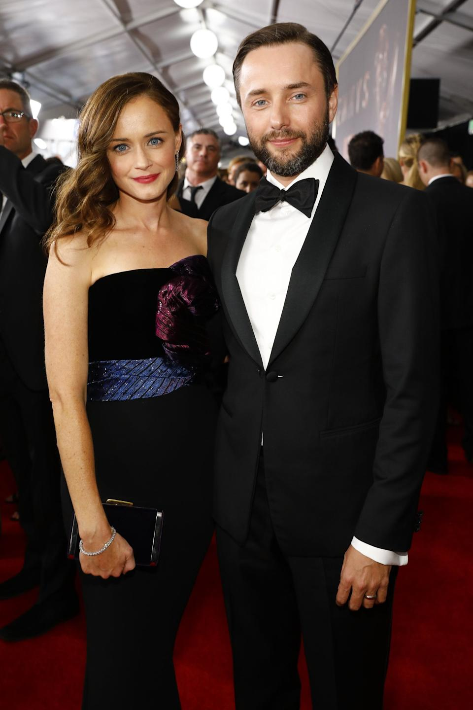 """Gilmore Girls"" actress <a href=""https://www.huffpost.com/entertainment/topic/alexis-bledel"" target=""_blank"" rel=""noopener noreferrer"">Alexis Bledel </a>married Vincent Kartheiser <a href=""https://www.hollywoodreporter.com/news/alexis-bledel-marries-vincent-kartheiser-723835"" target=""_blank"" rel=""noopener noreferrer"">in June 2014</a> after meeting on the set of ""Mad Men,"" on which he co-starred.<br /><br><br><br />The very private pair welcomed their first child, a son, in the <a href=""https://people.com/parents/vincent-kartheiser-alexis-bledel-welcome-son/"" target=""_blank"" rel=""noopener noreferrer"">fall of 2015</a>. While they rarely speak about their marriage, their famous friends have gushed about them as a couple. <br /><br><br><br />""They are such a yin and yang,"" said Elisabeth Moss -- another ""Mad Men"" cast member and Bledel's co-star on ""The Handmaid's Tale."" ""I've known Vinny for 12 years and Alexis is just the sweetest. I've never seen Vincent like this. It is really cool."""