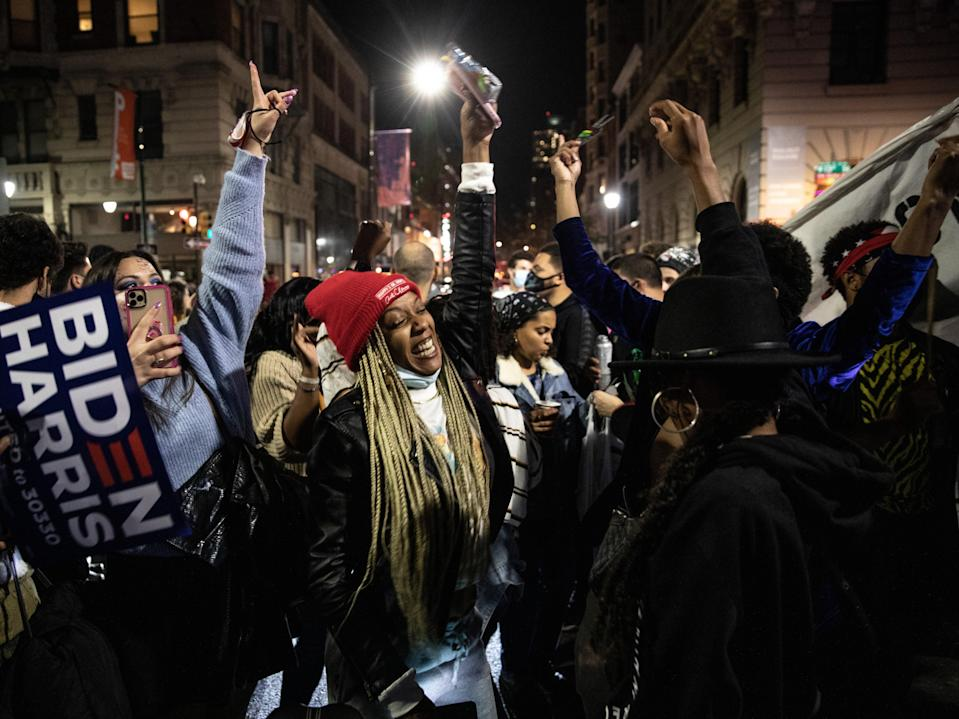 People dance in street after listening to President-elect Joe Biden address the nation on November 07, 2020.  (Getty Images)