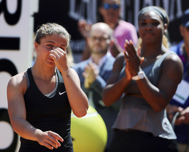 Italy's Sara Errani, left, walks past Serena Williams at the end of their final match at the Italian open tennis tournament in Rome, Sunday, May 18, 2014. Serena Williams kept the crowd from being a factor in a 6-3, 6-0 victory over 10th-seeded Sara Errani to win the Italian Open for the third time Sunday. (AP Photo/Gregorio Borgia)