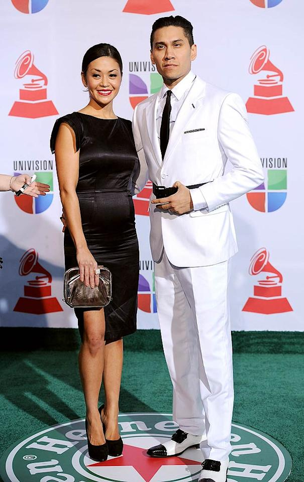 Black Eyed Peas' member Taboo went with an all-white suit while his wife, Jaymie Dizon, donned a little black dress. (11/10/2011)