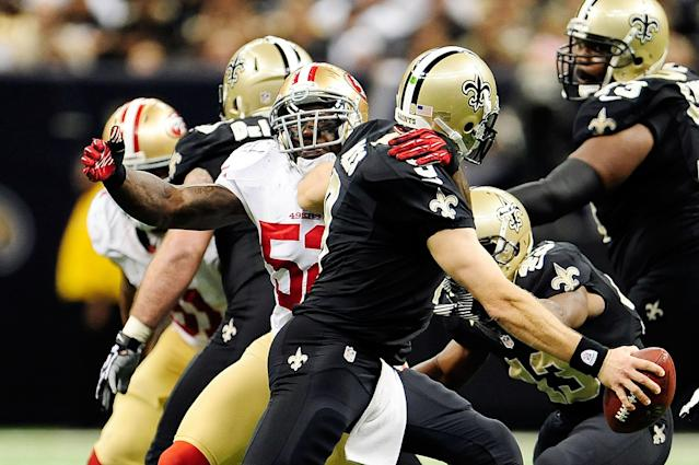 NEW ORLEANS, LA - NOVEMBER 25: Patrick Willis #52 of the San Francisco 49ers sacks Drew Brees #9 of the New Orleans Saints during a game at the Mercedes-Benz Superdome on November 25, 2012 in New Orleans, Louisiana. (Photo by Stacy Revere/Getty Images)