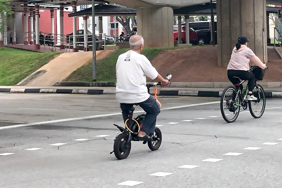 An elderly man on an e-scooter seen in Jurong on 5 November 2019