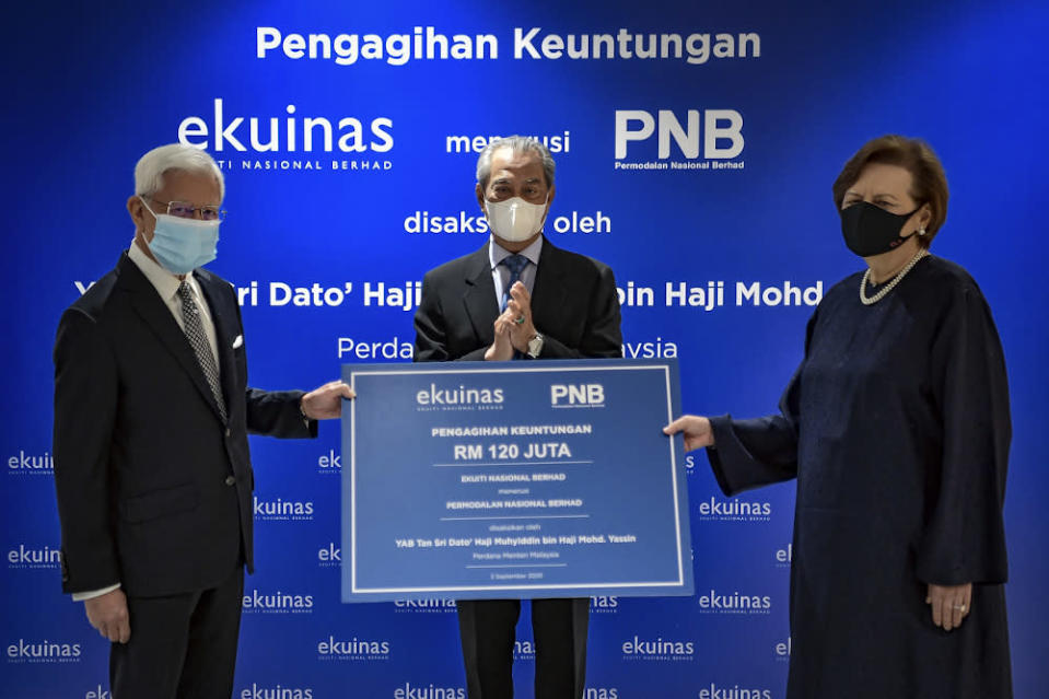 PNB chairman Tan Sri Dr Zeti Akhtar Aziz (right) is pictured with PM Tan Sri Muhyiddin Yassin (centre) during the presentation of Ekuinas profit distribution at Menara PNB, September 3, 2020. — Bernama file pic —