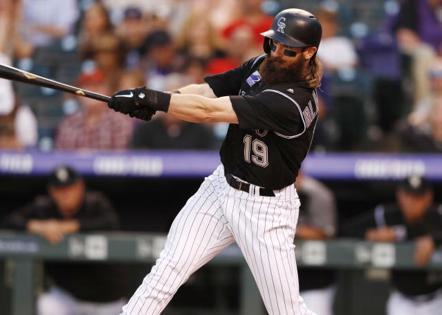 Colorado Rockies' Charlie Blackmon follows through on a solo home run off Arizona Diamondbacks starting pitcher Zack Greinke during the fifth inning of a baseball game Friday, June 8, 2018, in Denver. (AP Photo/David Zalubowski)