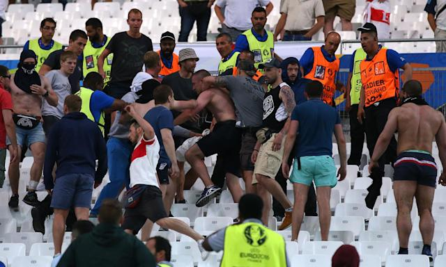 Fans clash after the Euro 2016 match between England and Russia.