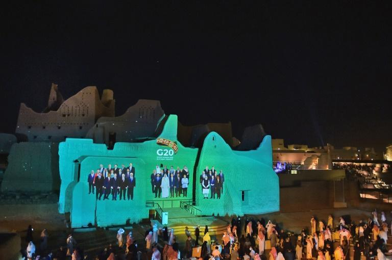 A group photo of G20 leaders is projected onto the walls of a historical site on the outskirts of the Saudi capital Riyadh, ahead of the virtual summit