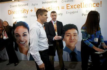 Recruiters speak with job-seekers at a career fair, part of the annual National Urban League Conference, in Philadelphia