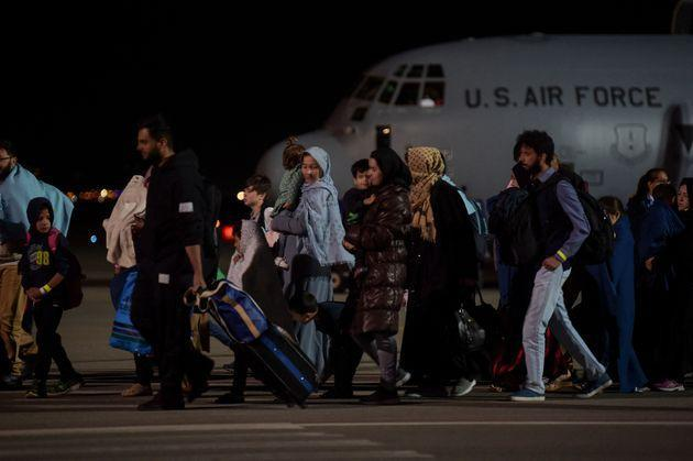 Afghan refugees, fleeing the Afghan capital Kabul, exit an US air force plane upon their arrival at Pristina International airport near Pristina on August 29, 2021. - Kosovo has offered to take in temporarily thousands of Afghan refugees evacuated by US forces from Kabul until their asylum claims are processed. (Photo by Armend NIMANI / AFP) (Photo by ARMEND NIMANI/AFP via Getty Images) (Photo: ARMEND NIMANI via AFP via Getty Images)
