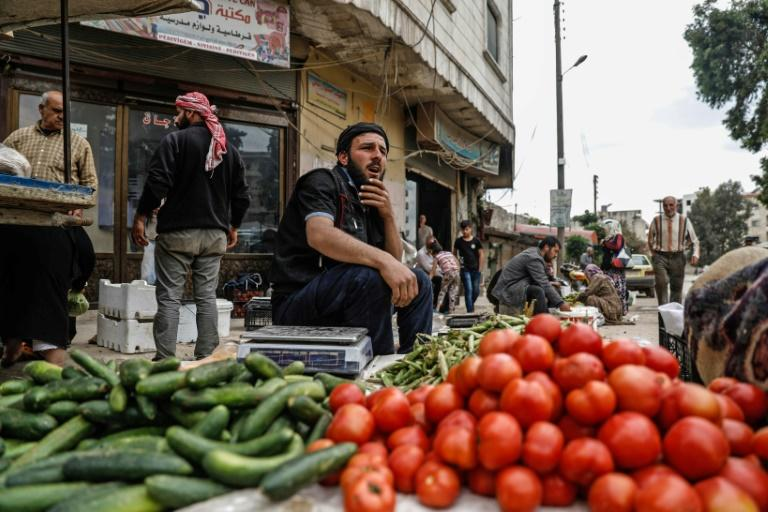 A general view taken on April 26, 2018, shows a man selling vegetables in the northern Syrian enclave of Afrin that Ankara-backed forces captured from Kurdish fighters in recent months
