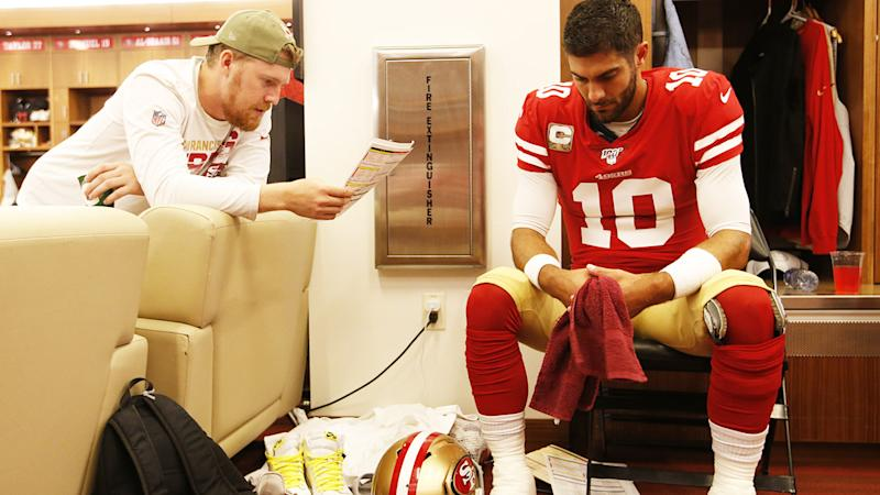 CJ Beathard and Jimmy Garoppolo, pictured here in the locker room prior to the game against the Seattle Seahawks.