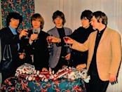 <p>The bandmates threw on their sport coats and toasted the holiday season in 1965. They were on tour in Australia at the time, but that didn't stop them from celebrating.</p>
