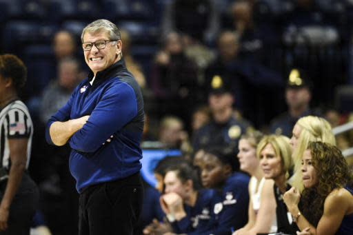 Connecticut head coach Geno Auriemma, left, reacts during the first half of a women's NCAA college basketball game against California, Sunday, Nov. 10, 2019, in Storrs, Conn. (AP Photo/Stephen Dunn)