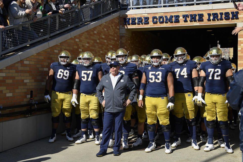 Head coach Brian Kelly stands in the tunnel in front of his team before Notre Dame's game against Pittsburgh on Oct. 13, 2018, in South Bend, Indiana. (Getty)