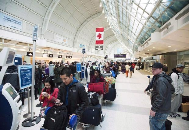 Canada's new rules offer extra compensation for passengers bumped by airlines