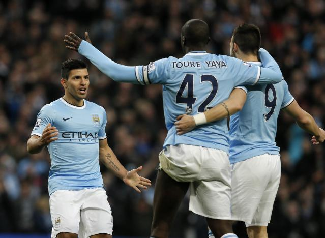 """Manchester City's Sergio Aguero (L) celebrates his second goal with Yaya Toure (C) and Alvaro Negredo during their English Premier League soccer match against Tottenham Hotspur at the Etihad Stadium in Manchesterr, northern England November 24, 2013. REUTERS/Phil Noble (BRITAIN - Tags: SPORT SOCCER) . NO USE WITH UNAUTHORIZED AUDIO, VIDEO, DATA, FIXTURE LISTS, CLUB/LEAGUE LOGOS OR """"LIVE"""" SERVICES. ONLINE IN-MATCH USE LIMITED TO 45 IMAGES, NO VIDEO EMULATION. NO USE IN BETTING, GAMES OR SINGLE CLUB/LEAGUE/PLAYER PUBLICATIONS. FOR EDITORIAL USE ONLY. NOT FOR SALE FOR MARKETING OR ADVERTISING CAMPAIGNS"""