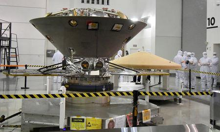 FILE PHOTO:    NASA's InSight spacecraft, destined for the Elysium Planitia region located in Mars' northern hemisphere, undergoes final preparations at Vandenberg Air Force Base, California, U.S., April 6, 2018.   REUTERS/Gene Blevins/File Photo
