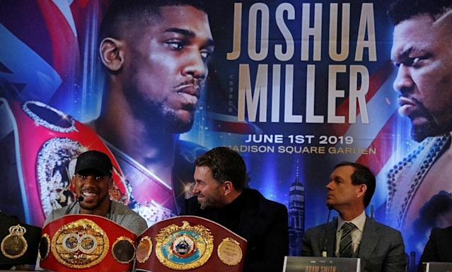 'I'm going to strip him of his soul' - Joshua on Miller (AFP Photo/Adrian DENNIS)