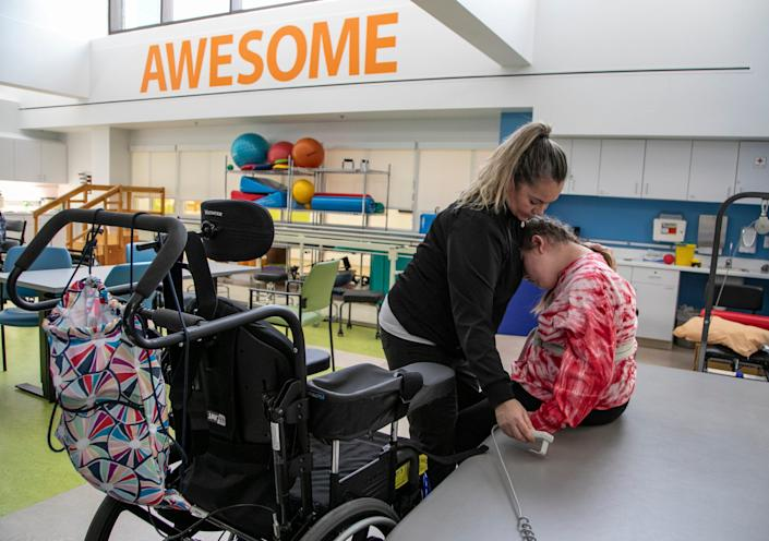 Physical therapist assistant Starr Sutton works with Savanah DeHart, 15, during an afternoon rehabilitation segment at the Mary Free Bed Rehabilitation Hospital in Grand Rapids Thursday, Jan. 23, 2020 to treat the debilitating effects of the Triple E (Eastern Equine Encephalitis) virus. DeHart was likely bitten by a an infected mosquito last summer and suffered stroke-like symptoms.