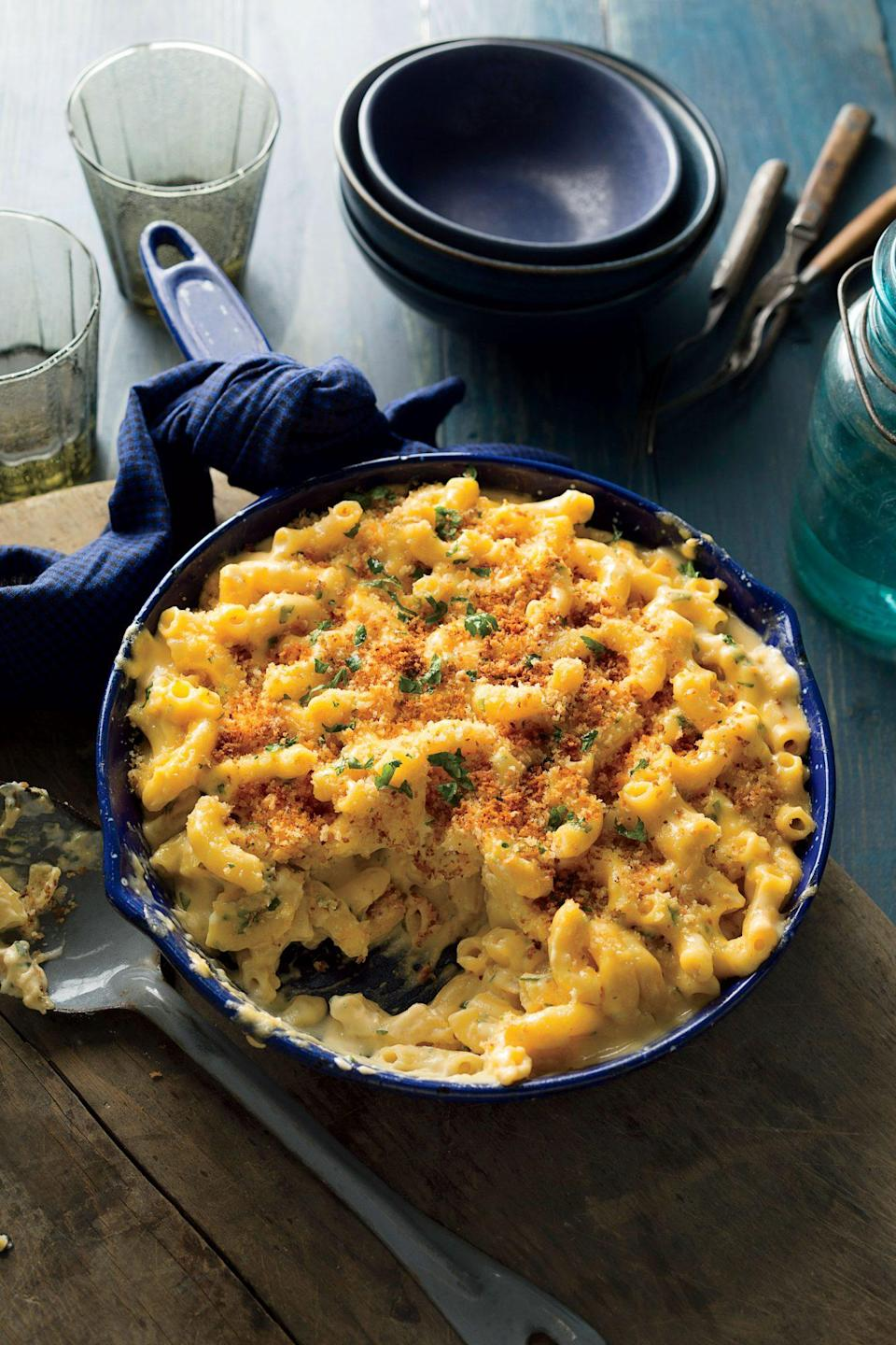 """<p><strong>Recipe: <a href=""""https://www.southernliving.com/recipes/skillet-mac-cheese-crispy-breadcrumbs-recipe"""" rel=""""nofollow noopener"""" target=""""_blank"""" data-ylk=""""slk:Skillet Mac and Cheese with Crispy Breadcrumbs"""" class=""""link rapid-noclick-resp"""">Skillet Mac and Cheese with Crispy Breadcrumbs</a></strong></p> <p>Baking your homemade mac and cheese in the skillet leaves you with perfect texture you can't find in a blue box.</p>"""