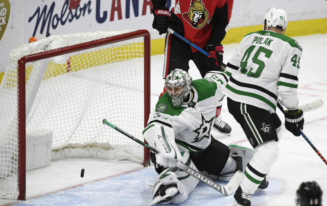 Dallas Stars goaltender Anton Khudobin (35) watches a shot by Ottawa Senators centre Jean-Gabriel Pageau enter the net during the first period of an NHL hockey game Sunday, Feb. 16, 2020, in Ottawa, Ontario. (Justin Tang/The Canadian Press via AP)