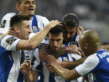 FC Porto won its first Portuguese league title in five seasons after a draw by rivals Benfica and Sporting Lisbon left both out of contention on Saturday.