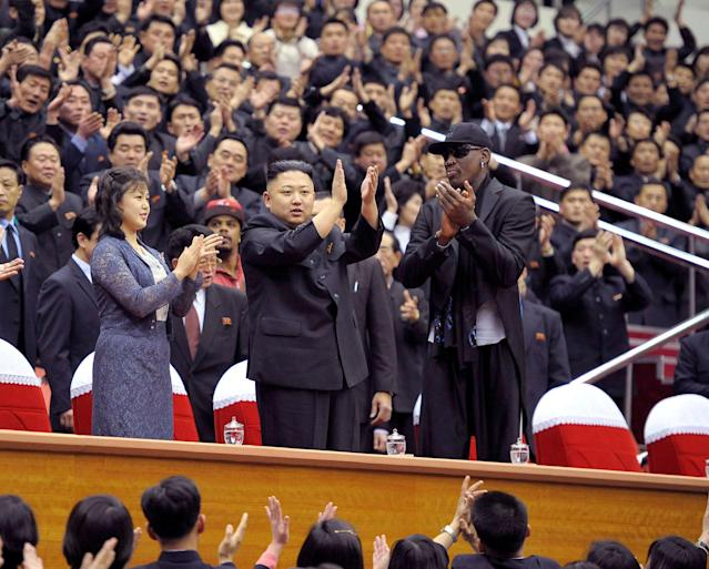 FILE PHOTO: North Korean leader Kim Jong-Un (C), his wife Ri Sol-Ju (L) and former NBA basketball player Dennis Rodman clap during an exhibition basketball game in Pyongyang in this undated picture released by North Korea's KCNA news agency on March 1, 2013. KCNA reported that a mixed basketball game of visiting U.S. basketball players and North Korean players was held at Ryugyong Jong Ju Yong Gymnasium in Pyongyang on February 28, 2013. REUTERS/KCNA/File photo ATTENTION EDITORS - THIS PICTURE WAS PROVIDED BY A THIRD PARTY. REUTERS IS UNABLE TO INDEPENDENTLY VERIFY THE AUTHENTICITY, CONTENT, LOCATION OR DATE OF THIS IMAGE. THIS PICTURE IS DISTRIBUTED EXACTLY AS RECEIVED BY REUTERS, AS A SERVICE TO CLIENTS. QUALITY FROM SOURCE. NO THIRD PARTY SALES. NOT FOR USE BY REUTERS THIRD PARTY DISTRIBUTORS. SOUTH KOREA OUT. NO COMMERCIAL OR EDITORIAL SALES IN SOUTH KOREA