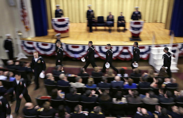 """Submarine sailors are dismissed during the decommissioning ceremony for the fire-damaged USS Miami nuclear sub at the Portsmouth Naval Shipyard, Friday, March 28, 2014, in Kittery, Maine. Rear Adm. Ken Perry, commander of the submarine Group Two in Groton, Conn., where the sub was based, acknowledged the seriousness of the event, but told the crowd they were there to celebrate the submarine and its crew's achievements. """"This is a tribute. This is a celebration of the ship's performance and the superb contributions to the nation's defense and this is how we're going to treat it. So I expect to see some smiles out there,"""" he said. (AP Photo/Robert F. Bukaty)"""