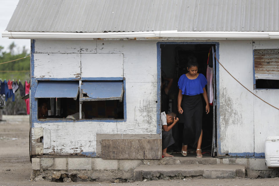 In this Sunday, April 7, 2019, photo, locals prepare to leave their house in Nuku'alofa, Tonga. China is pouring billions of dollars in aid and low-interest loans into the South Pacific, and even in the far-flung kingdom of Tonga there are signs that a battle for power and influence among much larger nations is heating up and could exact a toll. (AP Photo/Mark Baker)
