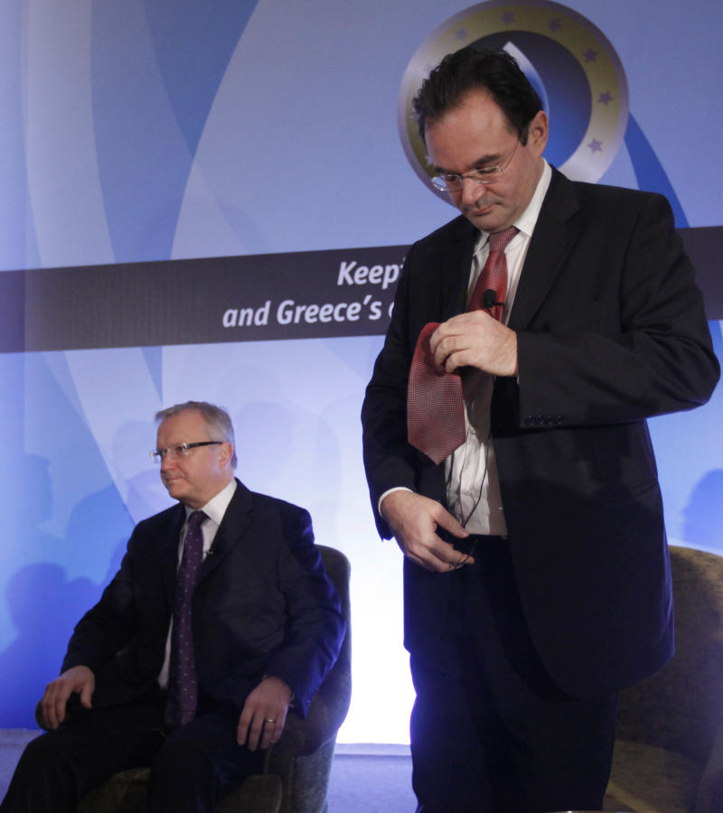 EU Monetary affairs Commissioner Olli Rehn, left,and Greek Finance Minister George Papakonstantinou attend an economy conference,  in Vouliagmeni, near Athens, on Thursday Dec. 9, 2010.Greece is negotiating a possible extension of its emergency loan repayment with the EU and the IMF. (AP Photo/Dimitri Messinis)