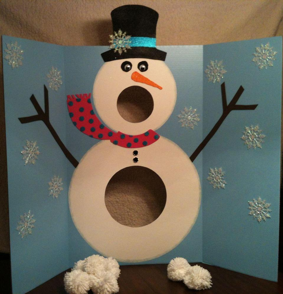 "<p>If you've got leftover three-sided poster board from your kid's last <a href=""https://www.goodhousekeeping.com/home/craft-ideas/how-to/g1389/diy-kids-activities/"" rel=""nofollow noopener"" target=""_blank"" data-ylk=""slk:science fair"" class=""link rapid-noclick-resp"">science fair</a>, we've got a way to put those extra boards to use. Kids will love decorating Frosty in their own signature style, and you can either craft fluffy pom-poms to toss or use beanbags for a quicker game.</p><p><em><a href=""http://intheleafytreetopsthebirdssing.blogspot.com/2012/01/mr-singing-snowman-pom-pom-snowballs.html"" rel=""nofollow noopener"" target=""_blank"" data-ylk=""slk:Get the tutorial at In the Leafy Treetops the Birds Sing Good Morning »"" class=""link rapid-noclick-resp"">Get the tutorial at In the Leafy Treetops the Birds Sing Good Morning »</a></em><br></p>"