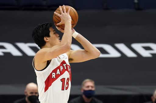 Toronto Raptors forward Yuta Watanabe, of Japan, shots against the Miami Heat during the second half of an NBA preseason basketball game Friday, Dec. 18, 2020, in Tampa, Fla. The Raptors are playing their home games in Tampa as a result of Canada's strict travel regulations stemming from the coronavirus pandemic. (AP Photo/Chris O'Meara)
