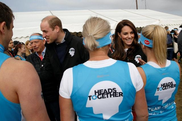 William and Kate pictured with London Marathon runners supporting their Heads Together mental health campaign which is launching a series of wellbing guides with Instagram. Luke MacGregor/PA Wire
